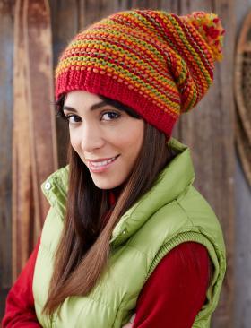 Разноцветная шапка с помпоном