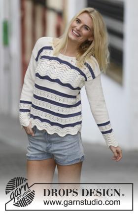 Цветной пуловер спицами с узором павлинье перо