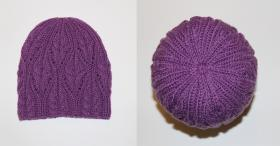 Женская шапочка с ажурными косами  Использовалась пряжа: A-elita quatro (50% шерсть, 50% акрил; 190м/100гр).